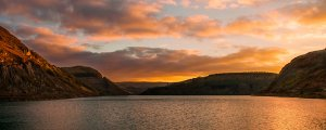 Sunset over reservoir red by Ian Baxter-Wild